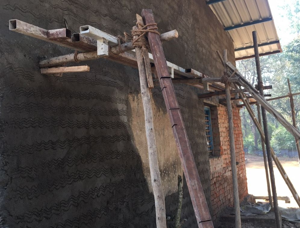 Repair of a house damaged by the monsoon in Londa, India