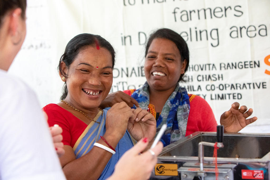 Two women are happy about the new machine. Now they can sell their products for a higher price.